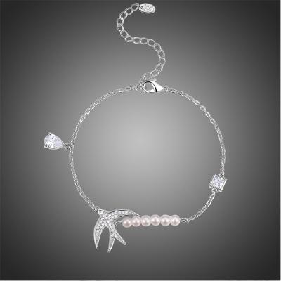 Náramek Swarovski Elements Albericci s perlou - vlašťovka
