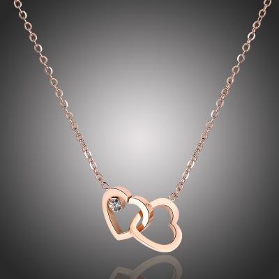 Ocelový náhrdelník se zirkonem Proplétaná srdce Gold chirurgická ocel