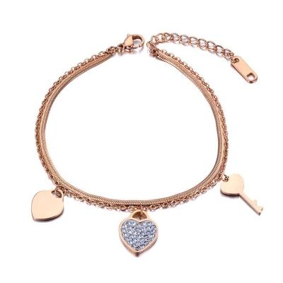 Ocelový náramek Leah Gold - srdce, klíč